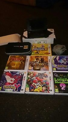 Nintendo 3DS XL Black Handheld System with charger and 8 games