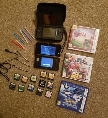 'Nintendo 3DS' with DS and 15 games. Both in black