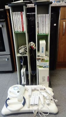 Nintendo Wii bundle with 15 games and two console games and accessories holder's