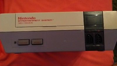 NES with 3 controllers, 5 games game genie and cleaning kit