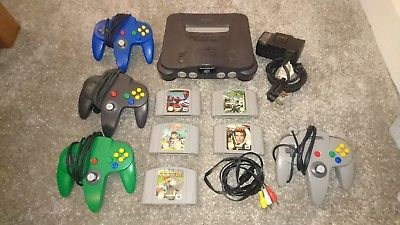 Nintendo 64 Console - 4 controllers - 5 games Inc Mario Kart and Goldeneye